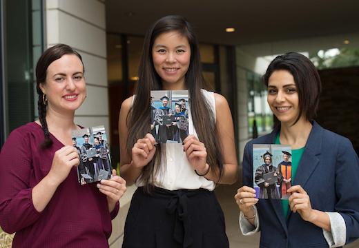 Alex Mendoza-Graf, Ashley Woo, and Sohaela Amiri hold photos of relatives from Pardee RAND commencement