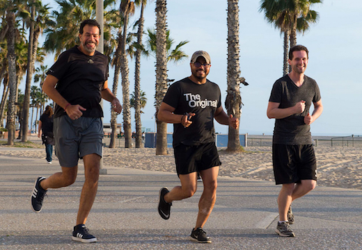 Brown Faculty Chair Malcolm Williams jogs on the beach with two students