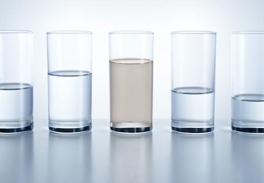Contaminated water in a glass