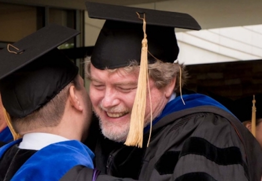 A graduate thanks Gery Ryan at Commencement 2016