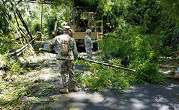 Members of the Puerto Rico National Guard's A Co. 1-296th Inf. Reg. clear roadways of fallen trees near Utuado, Puerto Rico, on Sept. 9, 2017, in the wake of Hurricane Irma, photo by Puerto Rico National Guard