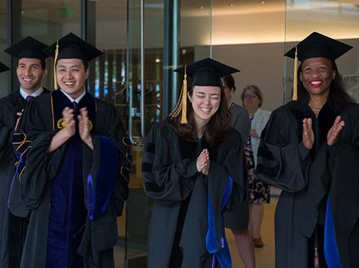 Ceremony participants applaud during Pardee RAND Graduate School's Commencement on June 16, 2018, photo by RAND Photography, Diane Baldwin/Maria Martin