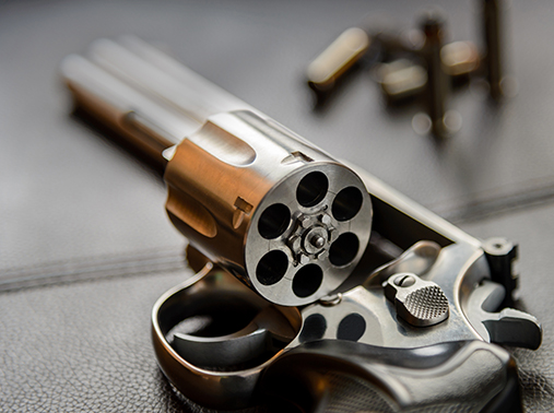 A revolver pistol with its cylinder open
