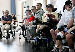 Service members involved in physical therapy at Brooke Army Medical Center in San Antonio wait for President Bush to visit, photo by Gerald Herbert/AP
