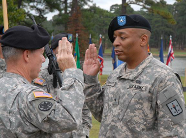 Brig. Gen. Mark McAlister recites the oath of office during his promotion ceremony at the Officers' Club