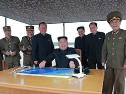 North Korean leader Kim Jong Un inspects a long and medium-range ballistic rocket launch drill in this undated photo released by North Korea's Korean Central News Agency in Pyongyang on August 30, 2017, photo by KCNA/via Reuters