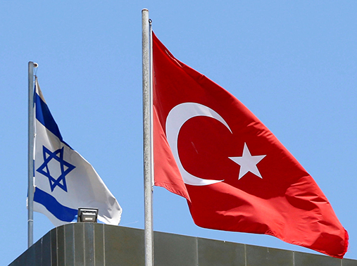 Turkish and Israeli flags fly atop the Turkish embassy in Tel Aviv, Israel, June 26, 2016