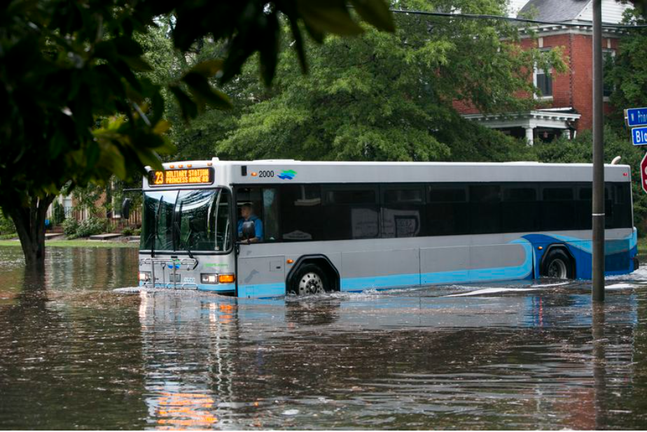 A bus drives through flooded roads in Ghent, Virginia, caused by Tropical Cyclone Sally, in September, 2020. Photo by Virginia Pilot / National Weather Service