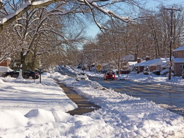 A neighborhood street after heavy snow in Falls Church, Virginia. Photo by amedved / Getty Images