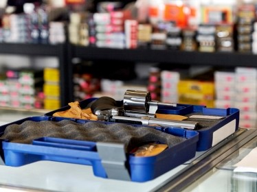 A revolver in a padded case on a gun store counter. Photo by wingedwolf / Getty Images