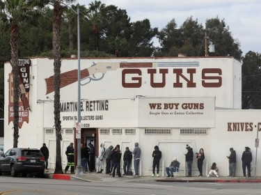 People wait in line outside to buy supplies at the Martin B. Retting, Inc. gun store amid fears of the global growth of coronavirus cases, in Culver City, California, U.S. March 15, 2020. Photo by Patrick T. Fallon / Reuters