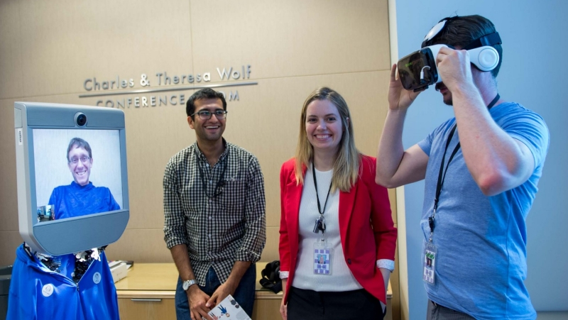 A student tries out VR goggles during the Tech Lab Pilot open house