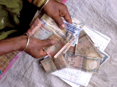 Woman counting money in Bangladesh