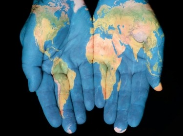 hands painted with world map