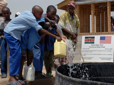 Children drink from well in Shant Abak, Djibouti, Africa