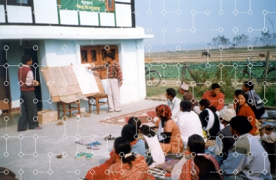 Agricultural extension meeting in Nepal, 2002, photo by APB-CMX/public domain, with decision-tree graphic overlay