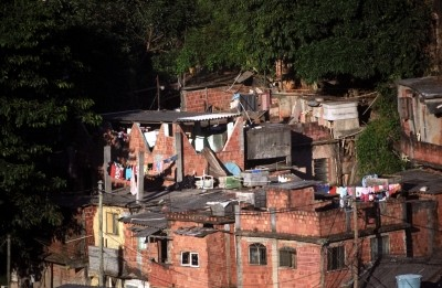 Developing Countries, Townhouse, Photography, No People, Shack, Stained, Water Tower - Storage Tank, Drying Rack, Clothesline, Color Image, Brownstone, Brick, Hut, Poverty, Togetherness, Chaos, Fragility, Messy, Dirty, Heap, Violence, Crime, Urban Scene, Outdoors, Horizontal, Distraught, Manual Worker, Rio de Janeiro, Brazil, Unripe, Tree, Day, Mountain, Narcotic, House, Slum