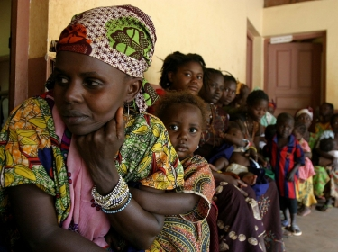 Women and children waiting in front of the Bolemba health centre in Central African Republic