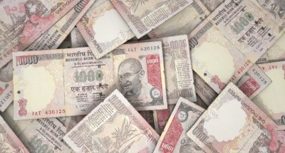Scattered pile of Indian rupee banknotes