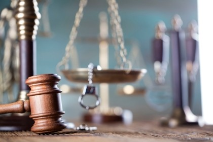 Gavel, scales of justice, and handcuffs