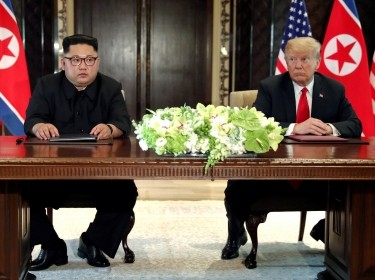 U.S. President Donald Trump and North Korea's leader Kim Jong Un hold a signing ceremony at the conclusion of their summit at the Capella Hotel on the island of Sentosa, Singapore, June 12, 2018
