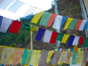 Bhutan prayer flags, photo by by Christopher Prentiss Michel/CC BY 2.0
