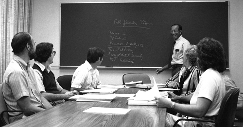 Charles Wolf teaches a RAND Graduate School class in 1980