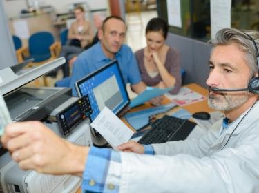 Medical transcriptionist preparing patient discharge, photo by auremar phovoir/Adobe Stock