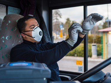 Bus driver wears a face mask to protect himself from the coronavirus epidemic, photo by Uliana Nadorozhna/Adobe Stock