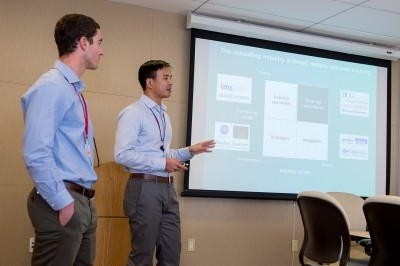 Alumni Eric Jesse (left) and Jon Wong discuss consulting careers