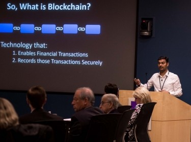 Pavan Katkar (cohort '14) presents research on Blockchain to the Pardee RAND Board of Governors
