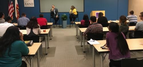 Mark Schuster talks with Sandy Buchan, photo by Terresa Cooper/Pardee RAND