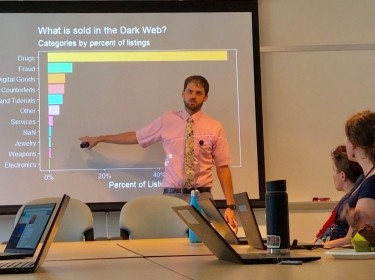 Noah Johnson presents some of his team's findings from the Dark Web Hackathon, photo by Todd Richmond/RAND Corporation