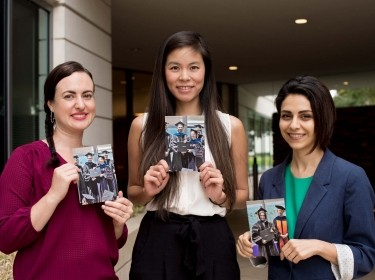 Students Alex Mendoza-Graf, Ashley Woo, and Sohaela Amiri hold photos of their relatives at Commencement, photo by Diane Baldwin/RAND Corporation