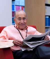 Charles Wolf reading in the RAND Library