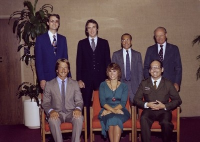 Dean Charles Wolf Jr. and new alumni at the RAND Graduate School commencement, 1980