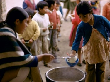Children in Ecuador waiting in meal line