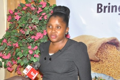 Nyambooze Joweria of Africa Innovations Institute participates in an interview at the Traditional Grains stakeholders meeting