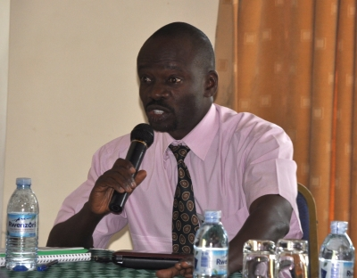 Yusuf Byaruhanga of Makerere University speaks at the Traditional Grains stakeholders meeting