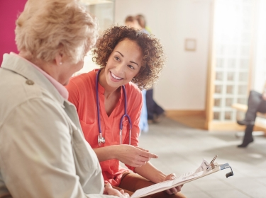 Nurse interviewing patient in the waiting room