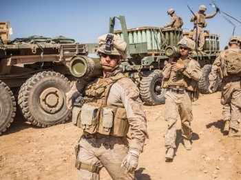 U.S. Marines carry 155mm rounds to an M777 Howitzer gun line to prepare for fire missions in northern Syria, March 21, 2017