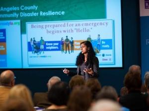 Anita Chandra giving a presentation