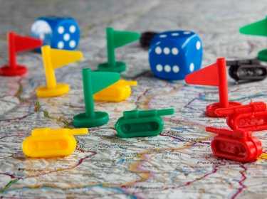 Flags, dice and game pieces representing tanks on a map