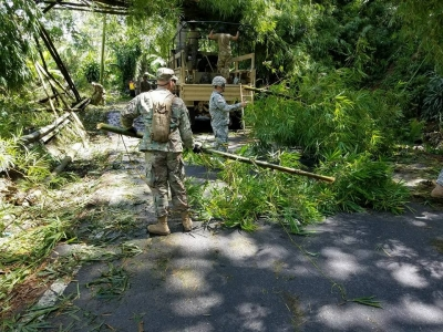 Members of the Puerto Rico National Guard's A Co. 1-296th Inf. Reg. clear roadways of fallen trees near Utuado, Puerto Rico, on Sept. 9, 2017, in the wake of Hurricane Irma.