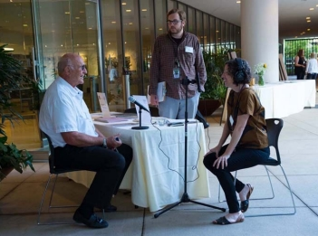 Archivists Cara McCormick and Eric Newman with a RAND alum recording an oral history at an alumni event, photo by Diane Baldwin/RAND Corporation