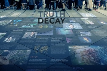 Truth Decay title on public space with people and information, photo by chombosan/Getty Images