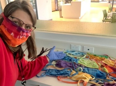 Monica Hertzman took her cheerful tie-dyed masks to RAND's Pittsburgh office