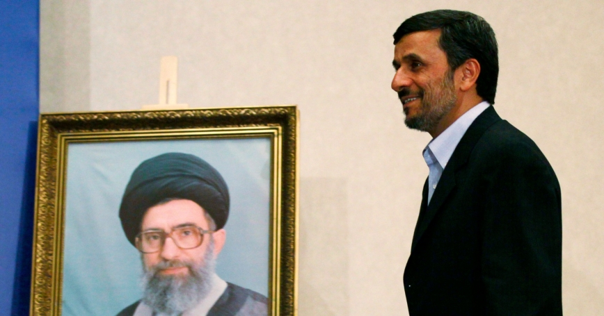 Iran's President Mahmoud Ahmadinejad walks past a portrait of Iran's Supreme Leader Ayatollah Ali Khamenei as he arrives at a news conference in Istanbul, May 9, 2011