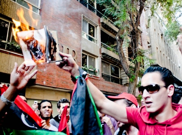 Protesters in Libya burning books
