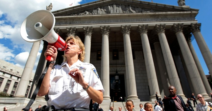 A federal court officer instructs court personnel during an evacuation of the Federal Court Building in New York, after a 5.9 magnitude earthquake that struck the East Coast, August 23, 2011, photo by Brendan McDermid/Reuters